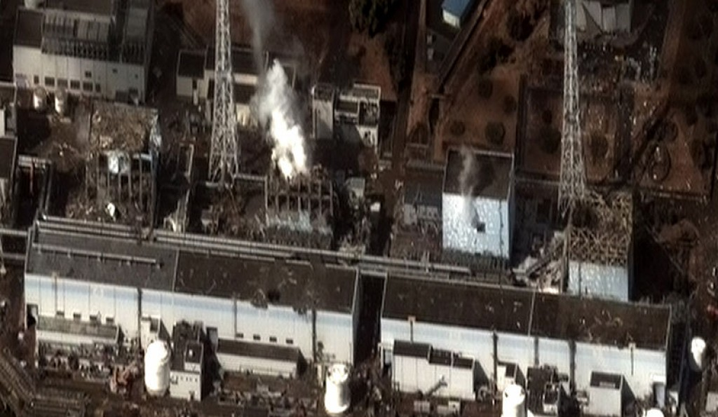 Satellite image on 16 March of the four damaged reactor buildings